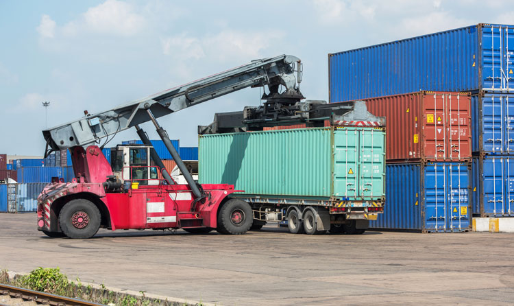 crane loading container on truck