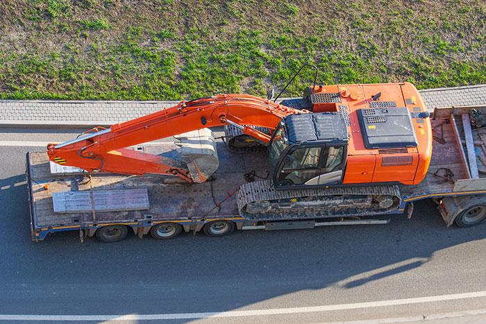 hauling construction equipment-on-trailer