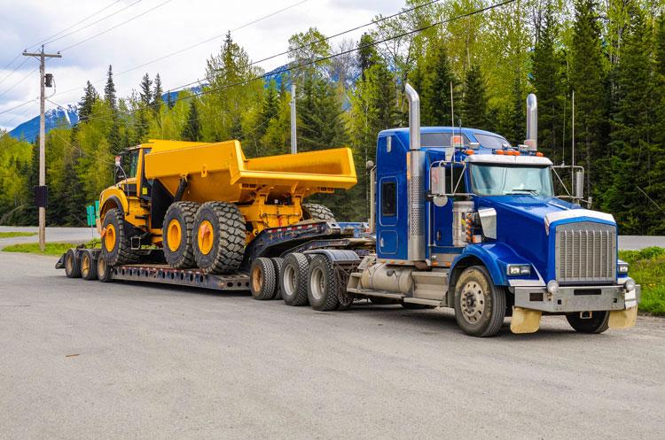 semi truck hauling dump truck
