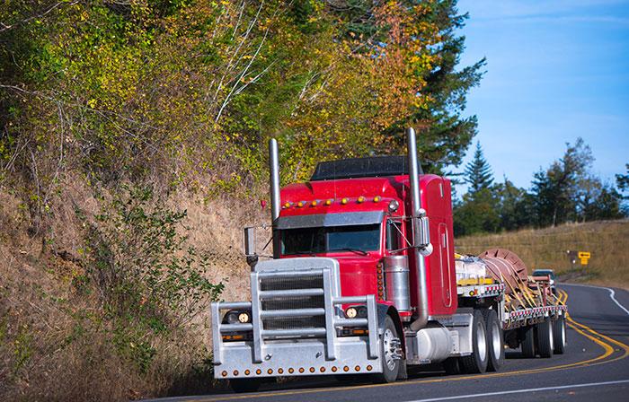 semi truck hauling fabricated item